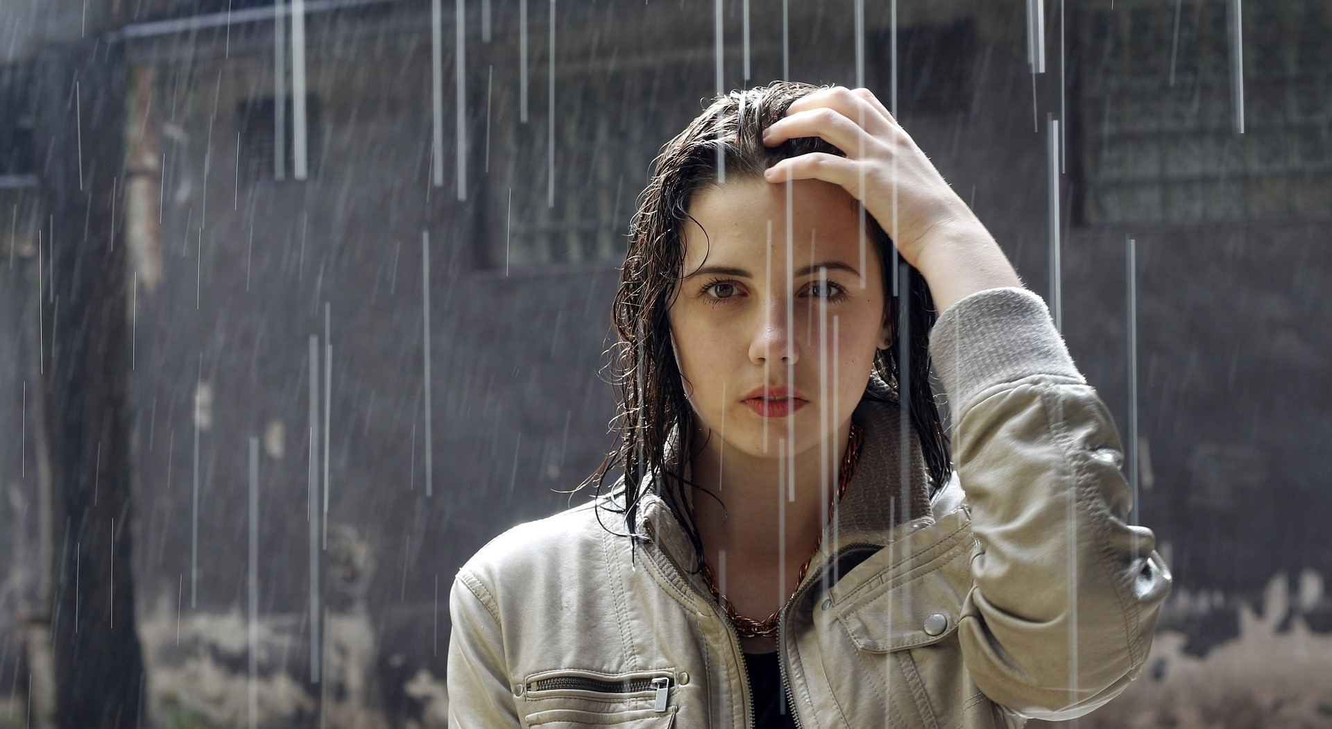A woman outside in unpleasant rain without an umbrella