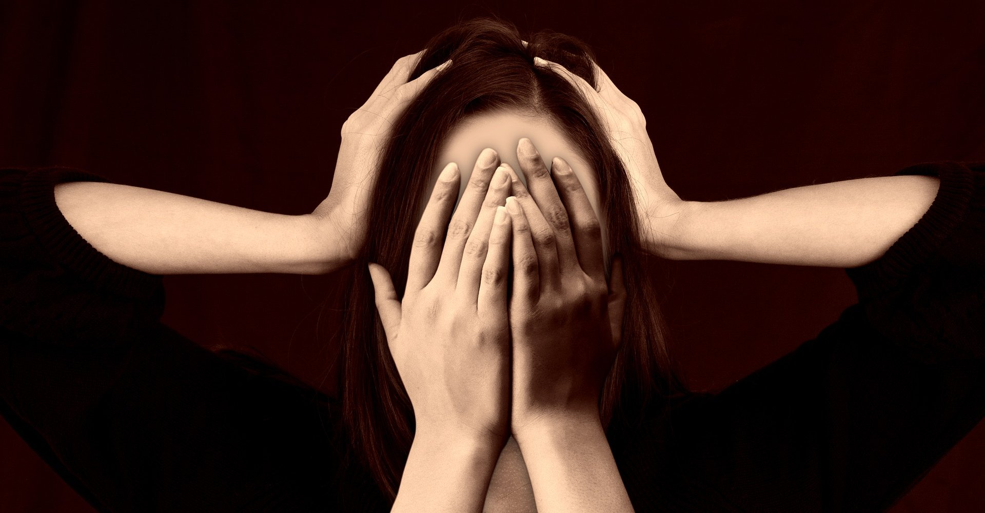 A woman covering her head in shame with two extra hands edited in covering her face, also in shame.
